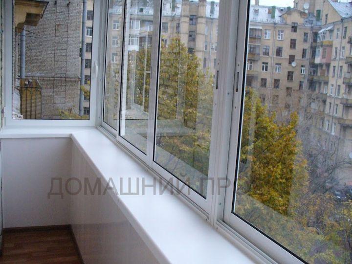 Алюминиевое остекление балкона с выносом