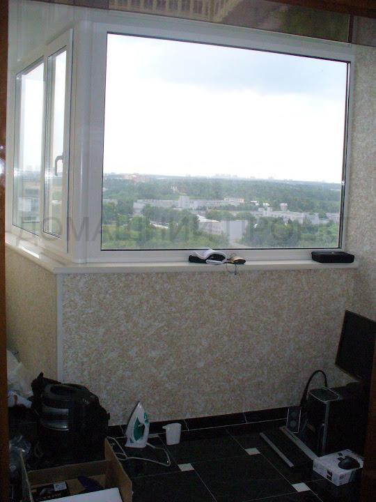 Отделка г-образного балкона пластиковыми панелями