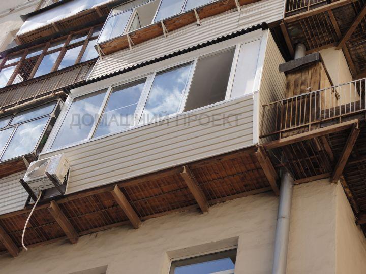 Остекление балкона алюминиевым профилем в сталинке