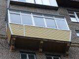 Внешняя отделка балкона с остеклением