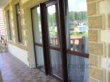 Ламинированные пластиковые двери из профиля Rehau