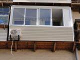 Остекление и отделка балкона сайдингом